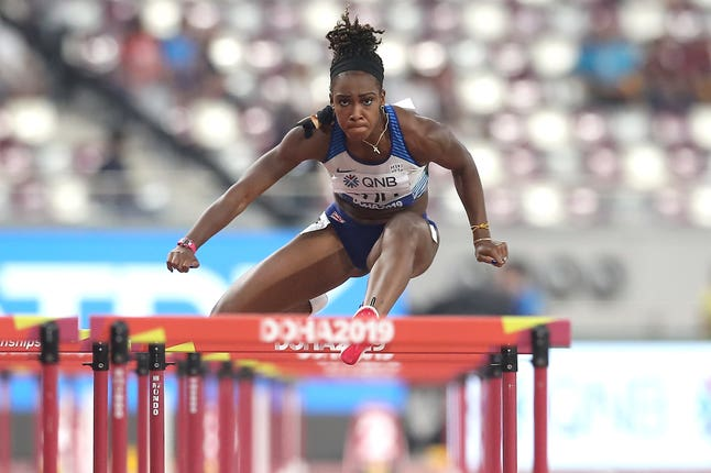 Cindy Ofili in action in her heat