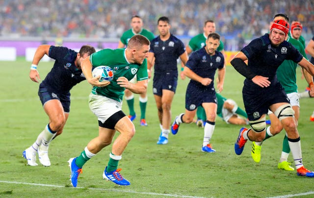Andrew Conway (with the ball) scored Ireland's fourth try against Scotland (Adam Davy/PA).