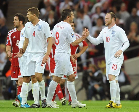 Former Derby boss Frank Lampard, centre, and Wayne Rooney