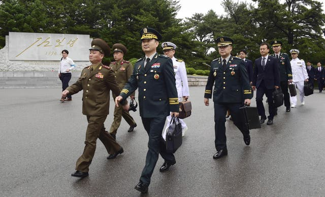 South Korean Major General Kim Do-gyun, second left, arrives for the meeting in Panmunjom