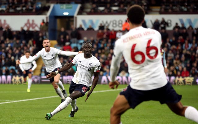 Sadio Mane scored a stoppage-time winners as Premier League leaders Liverpool beat Aston Villa 2-1 on Saturday afternoon