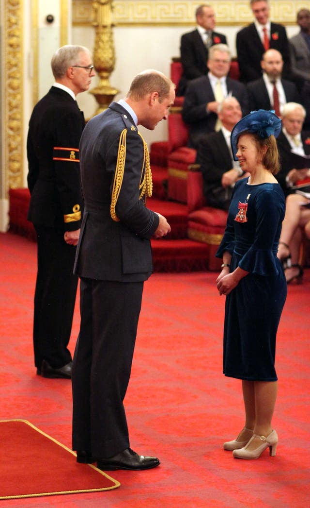 Sarah Gordy talks to William at Buckingham Palace