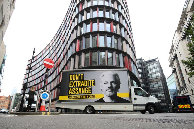 "A mobile advertising board with a ""Don't Extradite Assange"" message outside the Old Bailey, London (Aaron Chown/PA)"