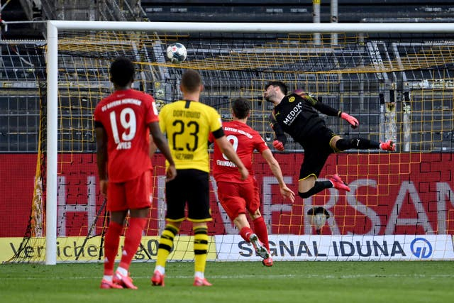 Dortmund goalkeeper Roman Burki is beaten by Joshua Kimmich