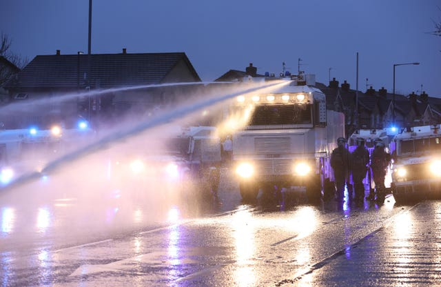 The PSNI use a water cannon on the Springfield road, during further unrest in Belfast