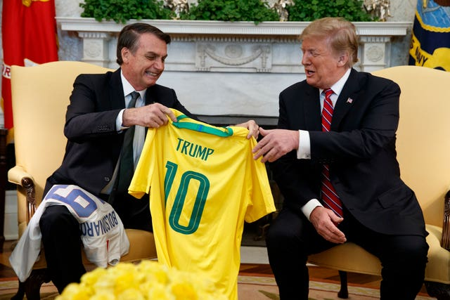 Jair Bolsonaro presents Donald Trump with a Brazil football shirt