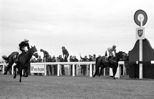 Red Rum (left) , ridden by Brian Fletcher, winning his first Grand National in 1973