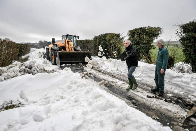 A JCB machine is deployed (Ben Birchall/PA)
