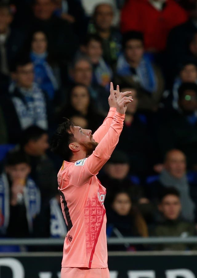 Lionel Messi celebrates against Espanyol (Joan Monfort/AP).