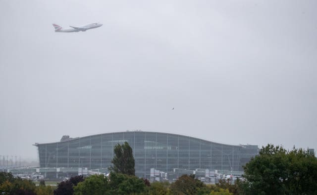 British Airways Boeing 747-400 aircraft, designated G-CIVY performs a fly past over Terminal 5 at Heathrow Airport (Andrew Matthews/PA)