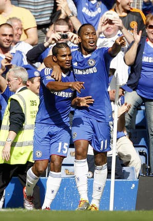 Florent Malouda, left, celebrates his goal against Stoke in August 2010 with fellow fast starter Didier Drogba