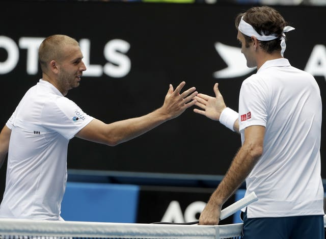 Dan Evans, left, made Roger Federer work for his victory