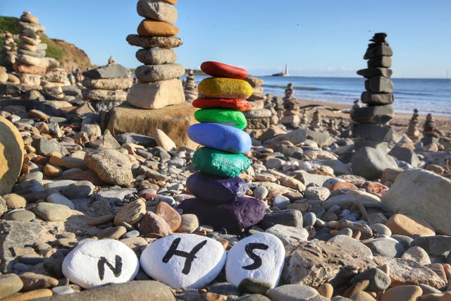 This pebble stack appeared on the beach at Whitley Bay - complete with a symbolic rainbow