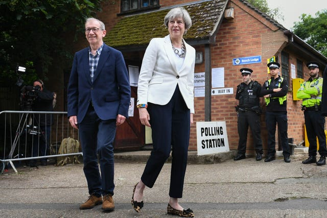 Prime Minister Theresa May and her husband Philip after casting their votes in 2017 (Stefan Rousseau/PA)