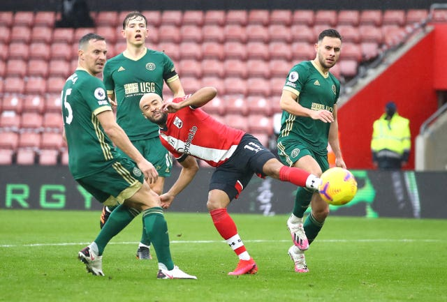 Nathan Redmond, centre, rounded off the scoring for Saints