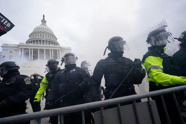 Police stand guard after holding off violent rioters who tried to break through a police barrier at the US Capitol in Washington on January 6