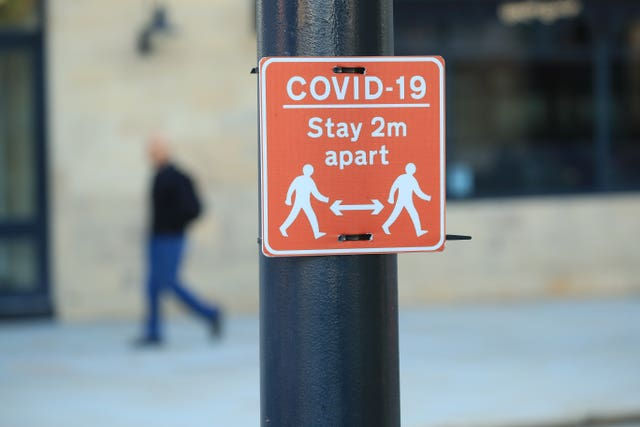 A sign advising people to stay two metres apart