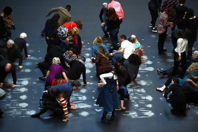 Guests get up after lying on Tania Bruguera's artwork