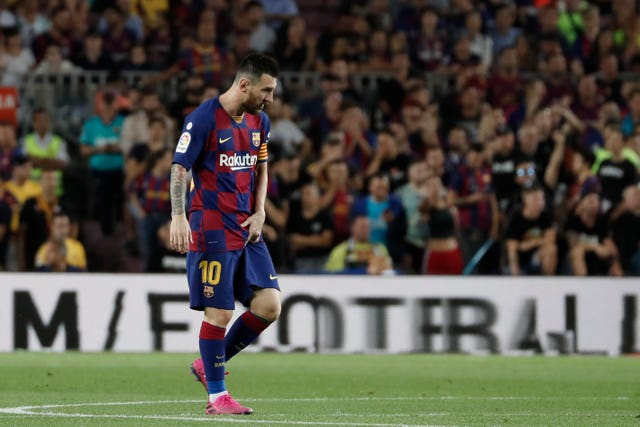 Barcelona's Lionel Messi leaves the pitch injured during his side's game against Villarreal