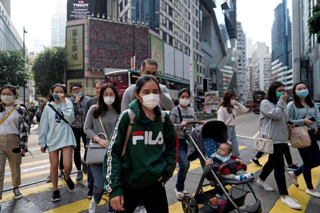 People wear masks on a street in Hong Kong