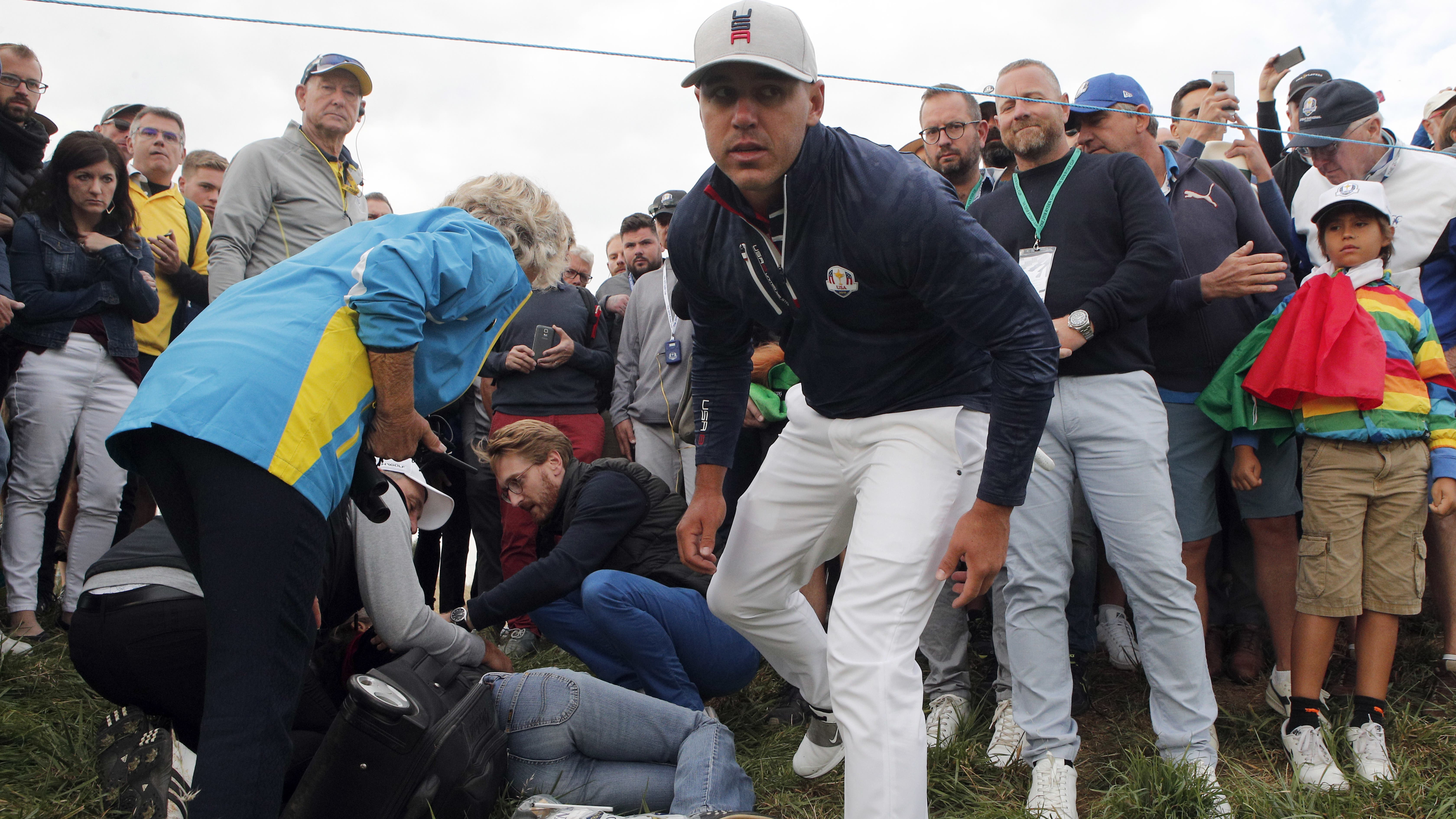 Brooks Koepka's tee shot on the sixth left a spectator needing treatment