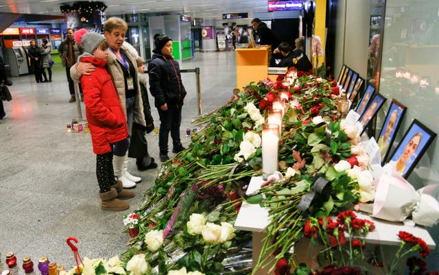 People look at a memorial at Borispil international airport in Kyiv, Ukraine