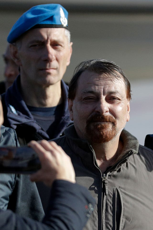 Italian fugitive Cesare Battisti arrives at Ciampino military airport in Rome
