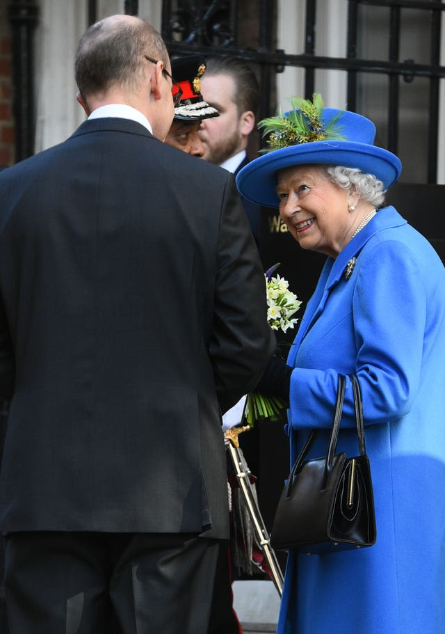 GCHQ director Jeremy Fleming talks to the Queen during a visit to Watergate House in London to mark its centenary
