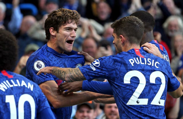Marcos Alonso celebrates his winner with Christian Pulisic