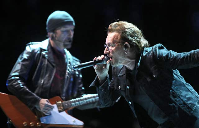 Bono and The Edge  on stage at The O2 Arena