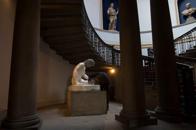 A statue being restored inside Wentworth Woodhouse (Aaron Chown/PA)
