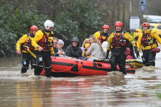 Members of the public are rescued after flooding in Nantgarw, Wales