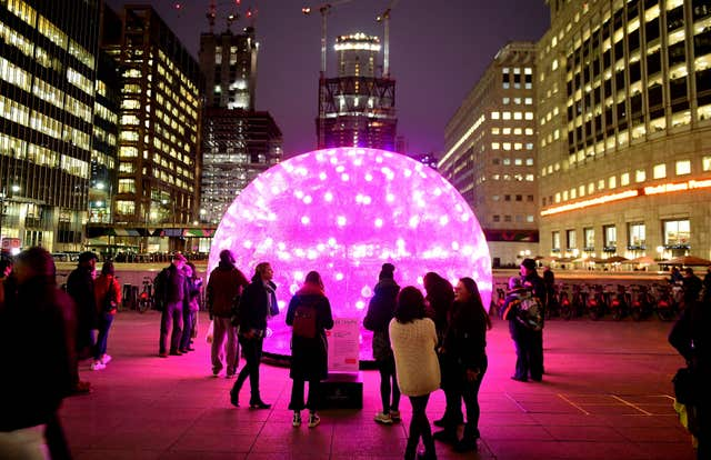 Members of the public look upon Sonic Light Bubble (Ian West/PA)
