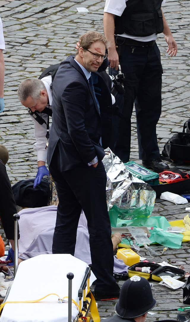 Tobias Ellwood in the aftermath of the Westminster attack (Stefan Rousseau/PA)