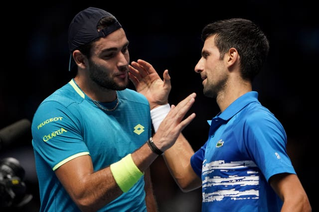 Matteo Berrettini (left) and Novak Djokovic shake hands at the end of their match