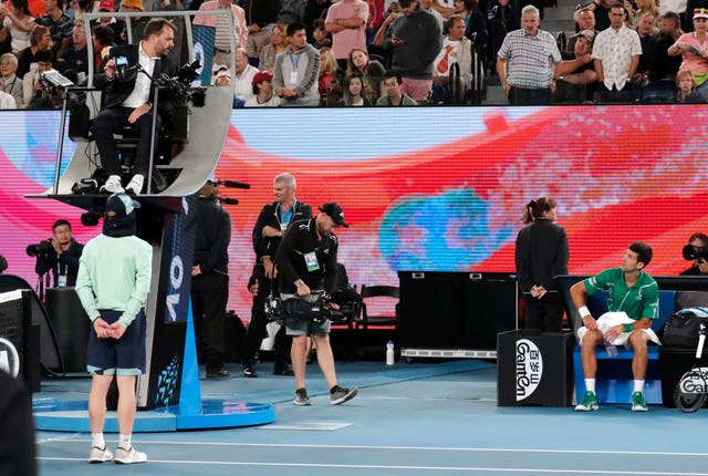 Novak Djokovic, right, argues with chair umpire Damien Dumusois