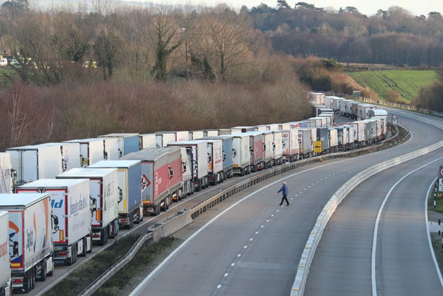 Freight lorries lined up on the M20 near Ashford, Kent