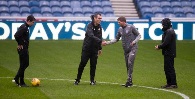 Gerrard and Saturday's referee inspect the Ibrox pitch