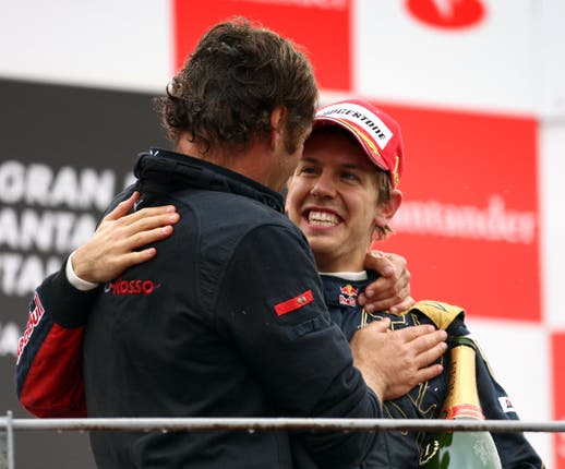 Former Toro Rosso team boss Gerhard Berger celebrates with Vettel following the German's maiden win of his career at the 2008 Italian Grand Prix (David Davies/PA)