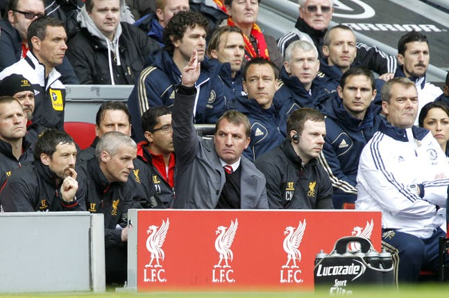 Brendan Rodgers, centre, in the Anfield dugout during his time as Liverpool manager