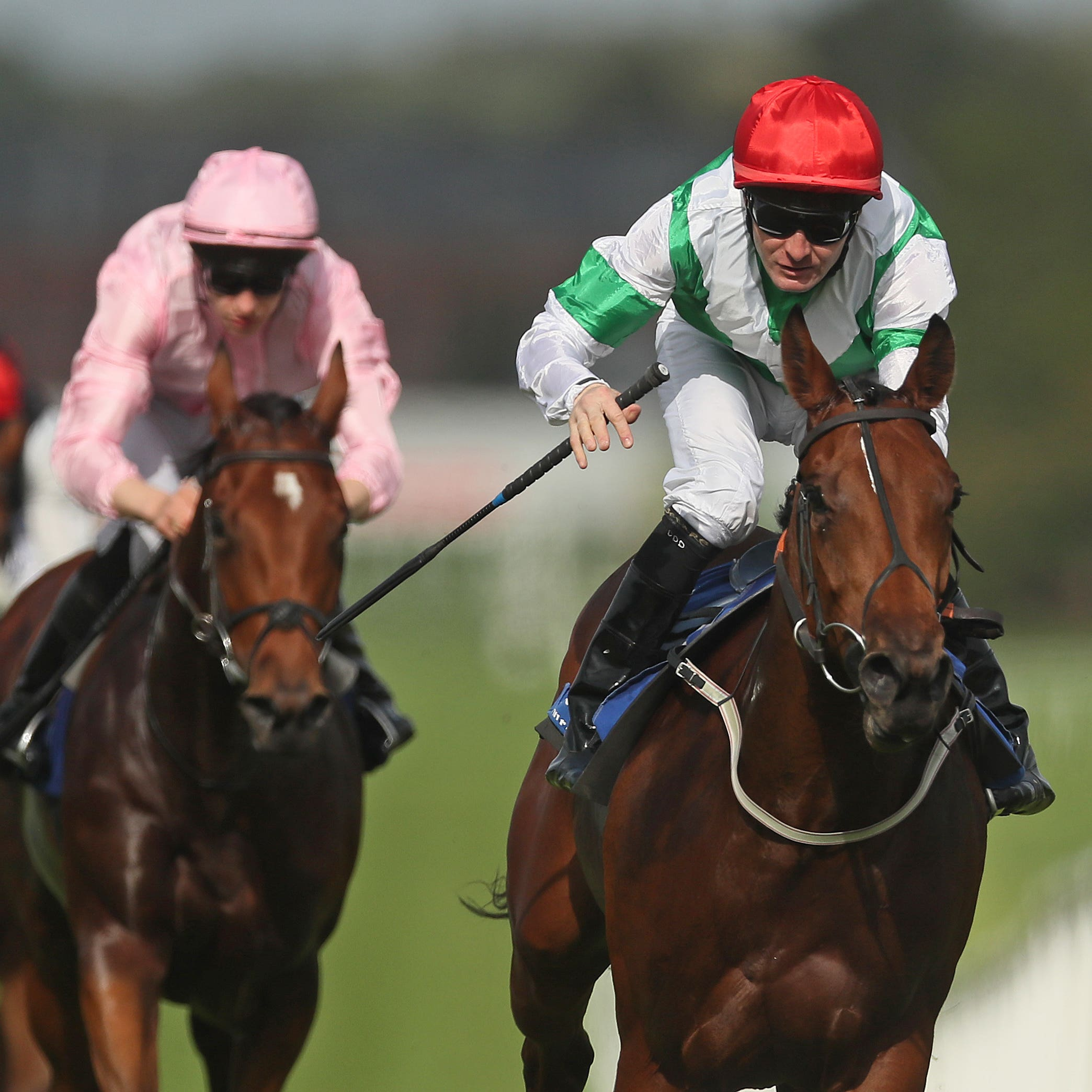 Ellthea (right) on her way to winning at Naas