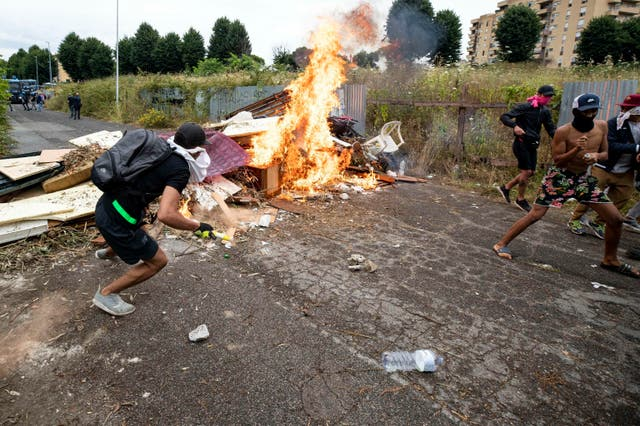 Squatters set fire to a barricade created outside an abandoned school on the outskirts of Rome before being evicted