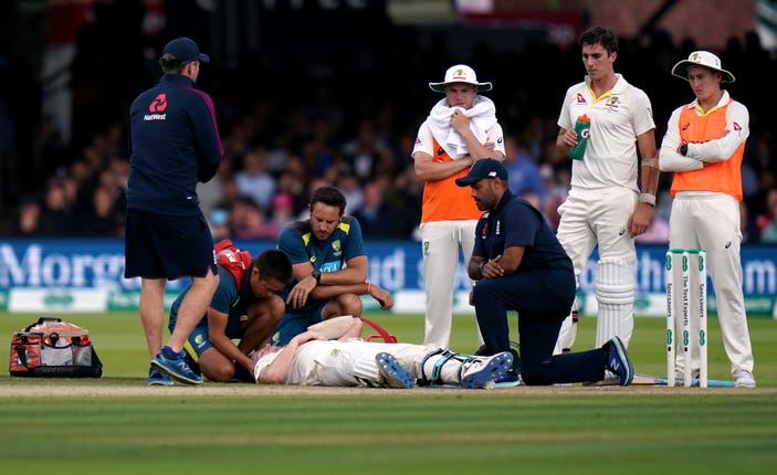 Australia's Steve Smith fell to the floor after a 92.4mph delivery from Jofra Archer struck him on the top of the neck