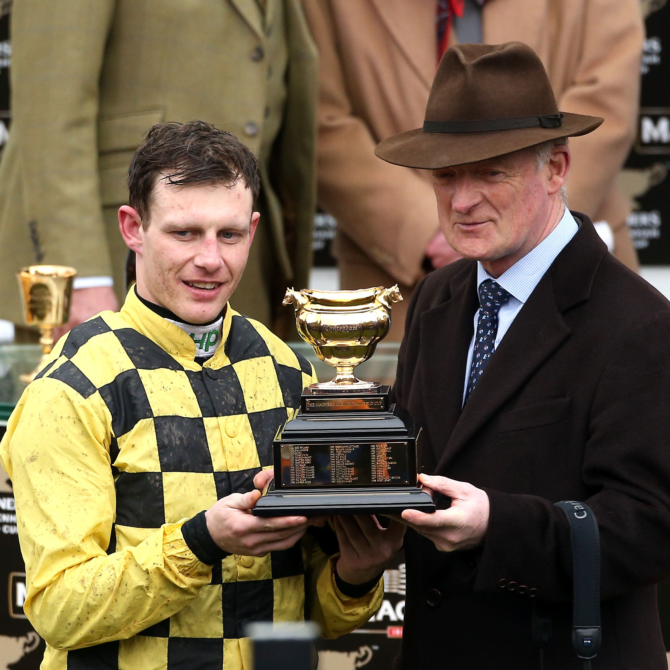 Jockey Paul Townend (left) and trainer Willie Mullins with the trophy after winning the Magners Cheltenham Gold Cup Chase with Al Boum Photo