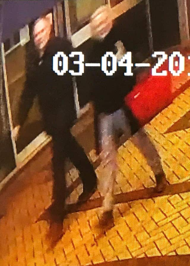 A CCTV image showing a man and woman walking through an alleyway connecting Zizzi's restaurant in Salisbury and the bench where Sergei Skripal was found (Snap Fitness 24/7/PA)