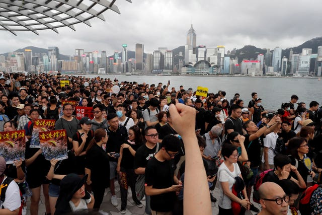 Protesters take part in a march in Hong Kong on Sunday