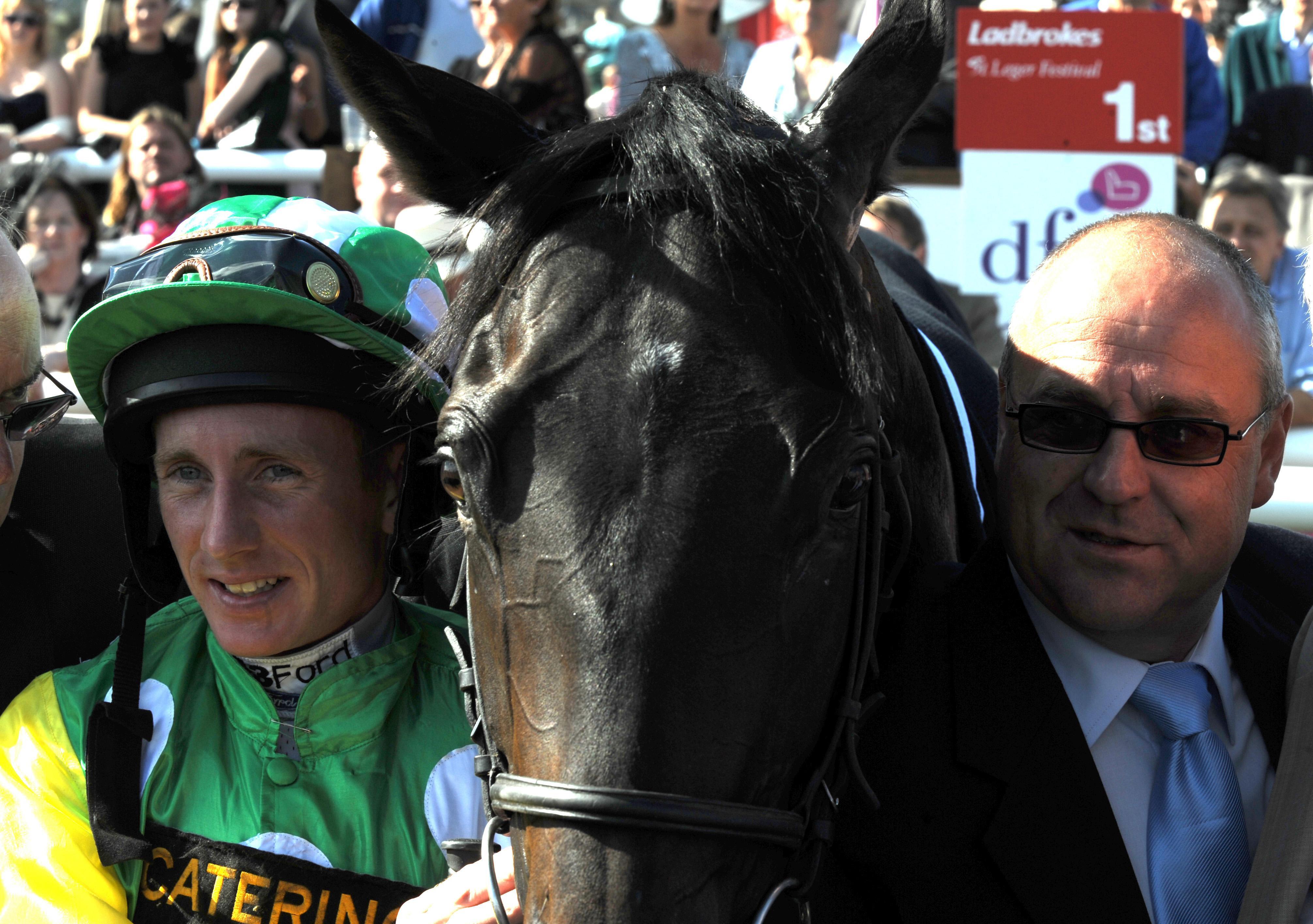 Paul Hanagan (left) and Richard Fahey teamed up to win with Mrs Hoo