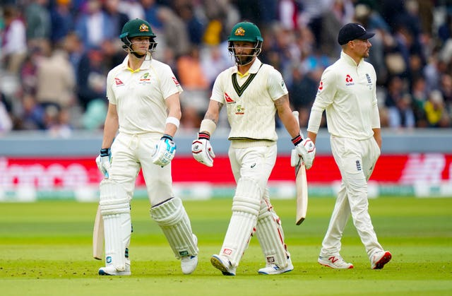 Steve Smith, left, remains at the crease alongside Matthew Wade