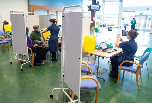 Patients receiving the Oxford/AstraZeneca Covid-19 vaccine at the NHS vaccine centre that has been set up in the grounds of the horse racing course at Epsom in Surrey