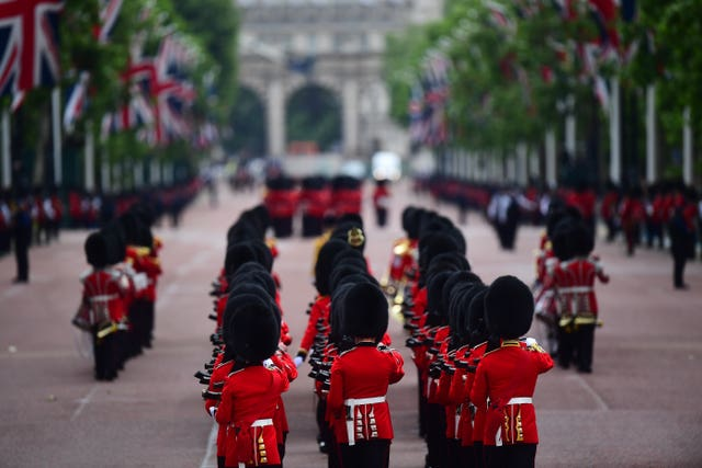 Soldiers makes their way from Buckingham Palace to Horse Guards Parade ahead of the ceremony